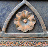 Fragment of a metal fencing. Flower. Stock Image
