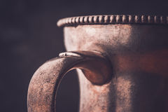 Fragment of the metal jug Stock Photo