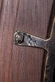 Fragment of metal pattern on wooden door with Royalty Free Stock Photo