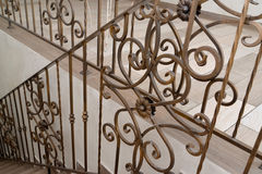 Fragment of a metal shod handrail of a ladder in hotel Stock Images