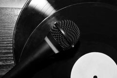 Fragment of the microphone with a vinyl record Royalty Free Stock Images