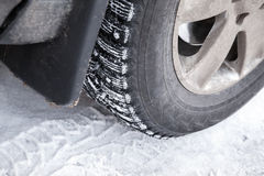 Fragment of modern automotive wheel with studded tires Royalty Free Stock Photo