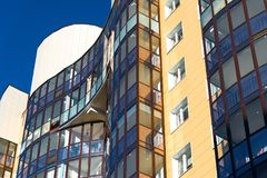 Fragment of modern beautiful apartment house with balconies Royalty Free Stock Photo