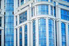 Fragment of modern blue office building with windows Stock Image
