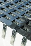 Fragment of a modern building. Abstract crossing lines on facade. Royalty Free Stock Photos