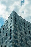 Glass and concrete.Blue. The fragment of modern building against the sky.Blue concept Stock Photo