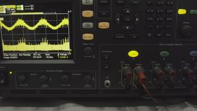Fragment of a modern digital oscilloscope. Scientific measuring equipment. Abstract industrial background. Digital. Oscilloscope is used by an experienced stock photography