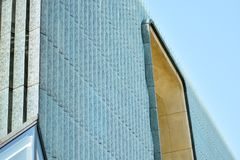 Fragment of a modern glass building. Modern architecture detai. modern building Royalty Free Stock Images