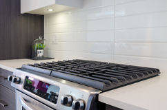 Fragment of a modern kitchen with a gas stove Stock Photography