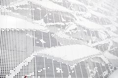 Fragment of a modern metal facade with perforations. Stock Images