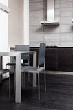 Fragment of modern minimalism style kitchen. With dining table Royalty Free Stock Image
