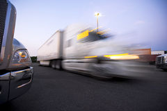 Fragment modern trucks on trakstope against moving truck with he Royalty Free Stock Image