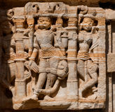 Fragment of monumental facade of traditional Hindu stone temple with stone artwork in Rajasthan Royalty Free Stock Images