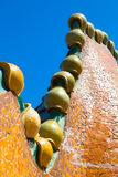 Fragment of mosaic dragon turrets on Antonio Gaudi house Casa Batllo roof Royalty Free Stock Images