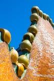 Fragment of mosaic dragon turrets on Antonio Gaudi house Casa Batllo roof royalty free stock images
