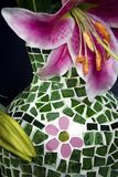 Fragment of mosaic vase and pink flowers on blue Stock Photos