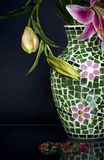 Fragment of mosaic vase and pink flowers on blue Stock Photography
