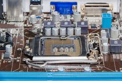 Fragment of motherboard of a desktop with CPU socket closeup Stock Photos