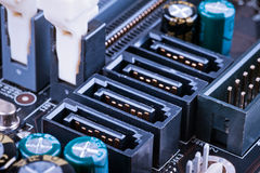 Fragment of the motherboard with SATA sockets Royalty Free Stock Photos