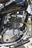 Fragment of motorcycle engine. Stock Photos