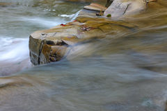 A fragment of the mountain river. Close up. Rocks and water flow Royalty Free Stock Photography