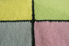 The fragment of multi-colored, knitted plaid is photographed by a close up. Royalty Free Stock Photography