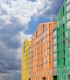 Fragment of a multicolored facade of the modern apartment comple Stock Photos
