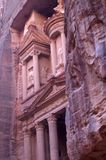 Fragment of the Nabatean church in the city of Petra. The temple is carved in a rock of pink stone. Petra or Raqmu, is a historical and archaeological city in Royalty Free Stock Photos