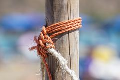 Fragment of nautical rope fence with weathered wooden.  royalty free stock photos