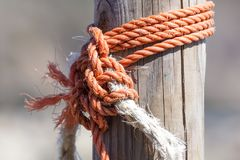 Fragment of nautical rope fence with weathered wooden.  royalty free stock image