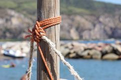 Fragment of nautical rope fence with weathered wooden.  royalty free stock photo
