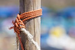 Fragment of nautical rope fence with weathered wooden.  stock photography
