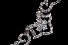 Fragment of a necklace. With  diamonds isolated on black background Stock Photo