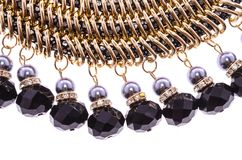 Fragment necklace with black beads on a white background Stock Images