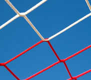 Fragment of net of football goals against the sky. Fragment of the net of football goals against the sky Royalty Free Stock Photo