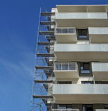 Fragment of a new inhabited apartment house and metal building c Royalty Free Stock Photo
