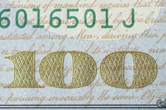 Fragment of new 100 US dollar banknote 2013 edition. Fragment of new american one hundred dollar banknote 2013 edition Stock Photo