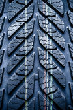 Fragment of new vehicle, car tyre, tire. Royalty Free Stock Photography