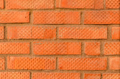 Fragment of a new wall. Wall made of red brick with striations Stock Photography
