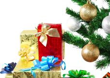 Fragment of New Year Tree with gift boxes Stock Photos