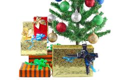 Fragment of New Year Tree with gift boxes Stock Image