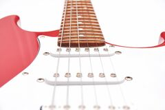 Fragment Of A Red Electric Guitar On A White Background. Part Of The Guitar. Music Object Stock Photos