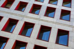 Free Fragment Of Modern Building Facade With Red Window Frames Stock Image - 141373061