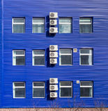 Fragment of the office building with several air conditioners Royalty Free Stock Images