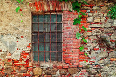Fragment of old abandoned brick house. Royalty Free Stock Images