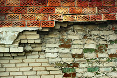 Fragment of old abandoned red and white brick wall Stock Photos