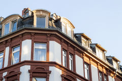 Fragment of an old architecture building facade with roof window Stock Photo