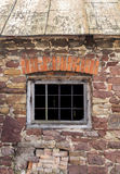 Fragment of old barn. Fragment of beaufitul old barn from the beginning of the 20th century with stone wall and a nice brick decor above window frame, vertical Stock Photography