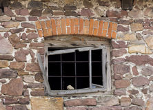 Fragment of old barn. Fragment of beaufitul old barn from the beginning of the 20th century with stone wall and a nice brick decor above window frame, horizontal Stock Image