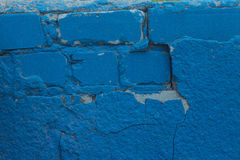 Fragment of Old blue plaster wall background Stock Image